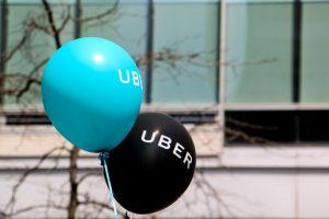 Montreal, Canada - April 29, 2016: A blue and a black balloon are floating outside at a pro Uber rally. The rally at Square Victoria, downtown Montreal, is held by drivers, clients and sympathizer of the ridesharing app.